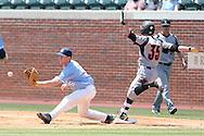 07 May 2016: Louisville's Colin Lyman (35) is safe at first base, beating the throw to North Carolina's Brooks Kennedy (5). The University of North Carolina Tar Heels played the University of Louisville Cardinals in an NCAA Division I Men's baseball game at Boshamer Stadium in Chapel Hill, North Carolina.