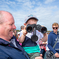 Conor Ryan from Quily with John O'Dwyer watching the Annual Pat Conway and friends Charity Swim from Lahinch to Liscannor Pier in aid of the Burren Chernobyl Project through his binoculars on Sunday afternoon