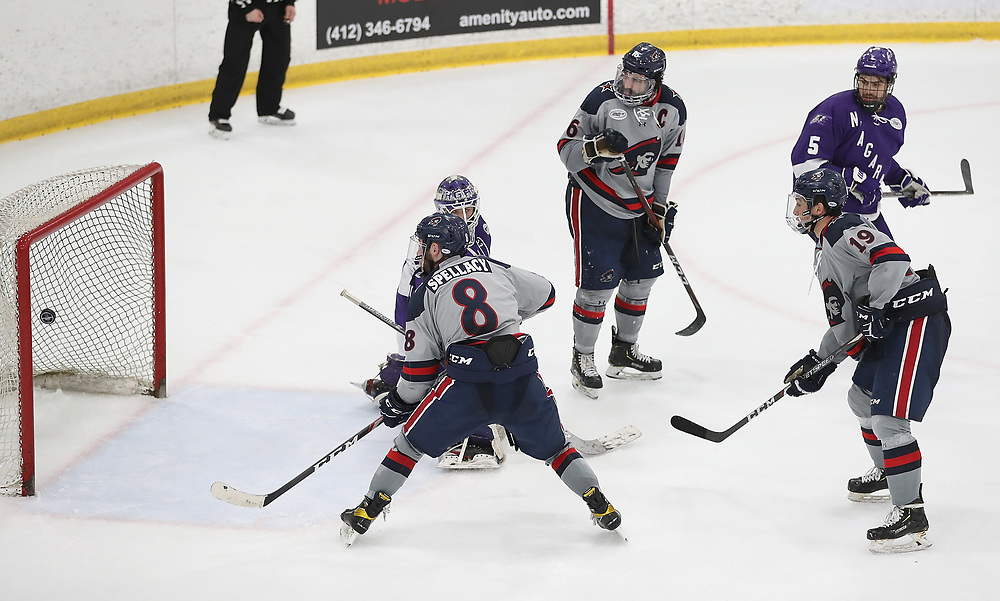 PITTSBURGH, PA - MARCH 14: Randy Hernandez #19 of the Robert Morris Colonials scores a goal in the third period during Game Three of the Atlantic Hockey Quarterfinal series against the Niagara Purple Eagles at Clearview Arena on March 14, 2021 in Pittsburgh, Pennsylvania. (Photo by Justin Berl/Robert Morris Athletics)