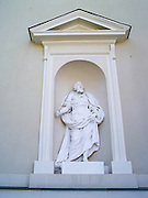 Exterior detail of a statue in a portico on the wall of the Vilnius Cathedral/Katedra, Vilnius, Lithuania