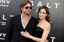 Brad Pitt and Angelina Jolie arriving for the premiere of 'Salt' held at the Grauman's Chinese Theatre in Los Angeles, CA, USA on July 19, 2010. Photo by Lionel Hahn/ABACAPRESS.COM