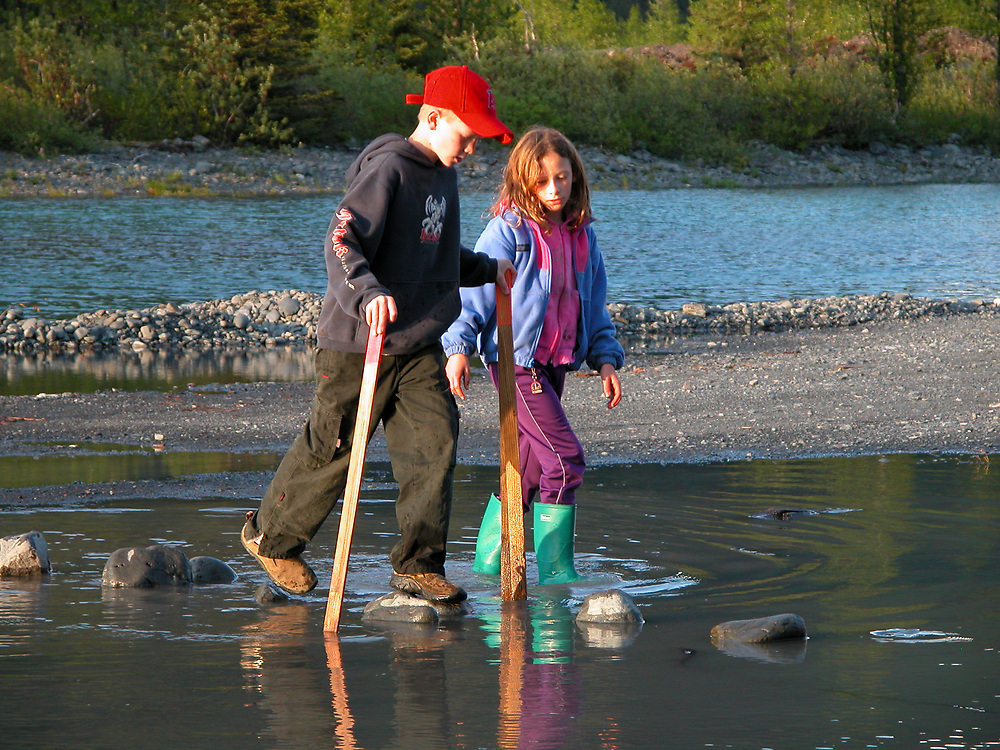 Alaska kids enjoy the outdoors in fall while on a hike up Bird Ridge in Chugach State park.