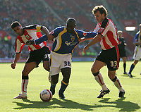 Photo: Lee Earle.<br /> Southampton v Cardiff City. Coca Cola Championship. 21/10/2007. Cardiff's Jimmy Floyd Hasselbaink (C) battles with Youssef Safri (L) and Christian Dailly.