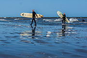 June 3, 2015 - Hastings, England, UK - Two British surfers leaves the calmed blue waters of the Sea, at the English south eastern coastline town of Hastings. (Credit Image: © Vedat Xhymshiti/ZUMA Wire)