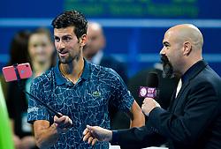 Novak Djokovic (L) of Serbia celebrates his win over Nikoloz Basilashvili of Georgia during their Quarter - Final of ATP Qatar Open Tennis match at the Khalifa International Tennis Complex in Doha, capital of Qatar, on January 03, 2019. Novak Djokovic won 2-1  (Credit Image: © Nikku/Xinhua via ZUMA Wire)