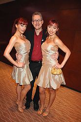 Left to right, GABRIELA IRIMIA, LEMBIT OPIK MP and MONICA IRIMIA at the Macmillan Cancer Suport Parliamentay Palace of Varieties Show held at the Intercontinental Hotel, Park lane, London on 7th February 2008.<br /><br />NON EXCLUSIVE - WORLD RIGHTS