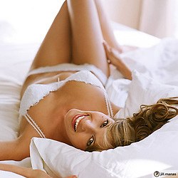 sexy woman in bed smiling