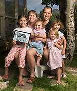 """NEWS&GUIDE PHOTO / PRICE CHAMBERS<br /> Ginny and Ken Mahood have four children. From left, Emily, 8, Gabriella, 1, Maria, 3, and Julia, 5. The couple lost their fifth child, Emily's twin sister Clare, to an inoperable brain tumor in 2005. The doctors said she had a 10 percent chance of surviving. """"You have to cling to that she is part of that 10 percent,"""" Ken Mahood said."""