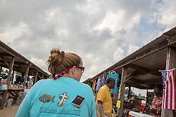 religious woman with a Jesus Tee shirt at a flea market in South Carolina