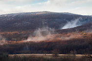 Town of Cornwall, New York - Fog in front of Schunnemunk Mountain on a late fall morning on Dec. 17, 2018.