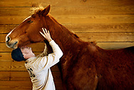 Wateree Correctional Institution inmate and Thoroughbred Retirement Foundation's groom elite certification program trainee Joshua Reynolds, 27, bonds with his favorite horse, Little Me Too, after a  grooming session. Photography by Chris Aluka Berry/ ALUKAStorytelling Photography.com)