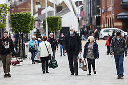 © Licensed to London News Pictures. 14/05/2021. Bolton, UK. Shoppers in Bolton town centre on Friday afternoon. Bolton now has the highest infection rate in Britain at 192.3 cases per 100,000. Photo credit: Adam Vaughan/LNP