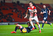 John Marquis of Doncaster Rovers (9) is tackled by Sam Hart of Southend United (42) during the EFL Sky Bet League 1 match between Doncaster Rovers and Southend United at the Keepmoat Stadium, Doncaster, England on 12 February 2019.