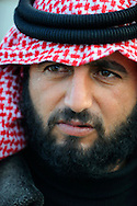 Beard is Muhammad sons name is Muhammad and guy with diamonds on shirt is Budasora or Bedia
