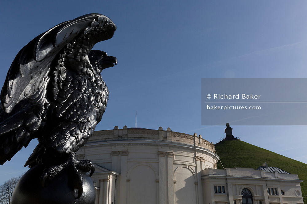 A statue of the French Imperial Eagle, still watching over the battlefield exhibitions of the Panorama and Lion's Mound at the Waterloo battlefield, on 25th March 2017, at Waterloo, Belgium. The French Imperial Eagle refers to the figure of an eagle on a staff carried into battle as a standard by the Grande Armée of Napoleon I during the Napoleonic Wars. Although they were presented with regimental colours, the regiments of Napoleon I tended to carry at their head the imperial eagle. Waterloo was fought  on 18 June 1815 between a French army under Napoleon Bonaparte,  defeated by two of the armies of the Seventh Coalition: an Anglo-led Allied army under the command of the Duke of Wellington, and a Prussian army under the command of Gebhard Leberecht von Blücher, resulting in 41,000 casualties.