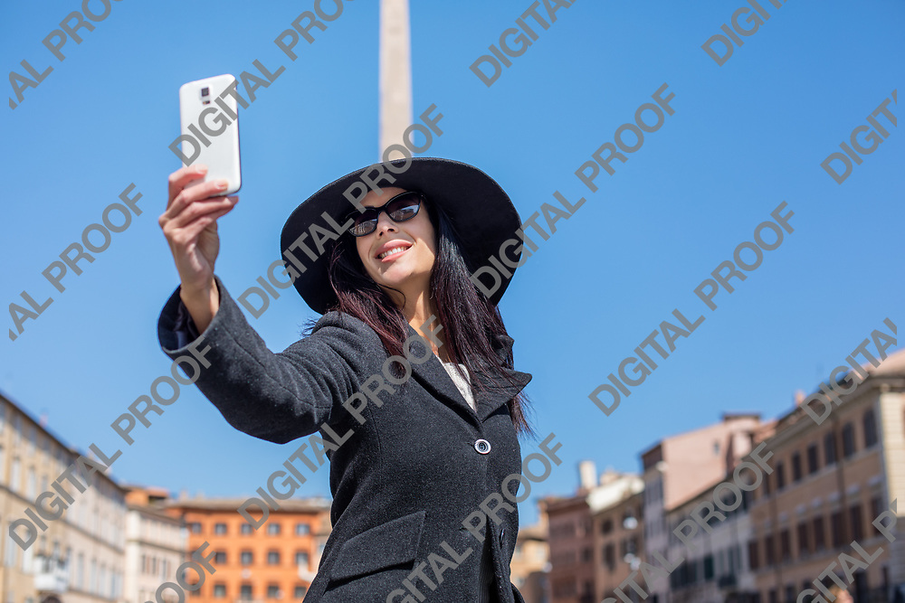 Happy executive  woman making selfie in piazza Navona Rome Italy