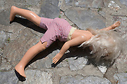 doll laying on pavement
