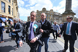© Licensed to London News Pictures. 20/05/2019. Newcastle, UK. Nigel Farage has had what apears to be a milkshake thrown over him while campaigning in Newcastle city centre today as part of a whistle-stop tour of the UK ahead of the European elections on the 23rd May. Photo credit: Andrew McCaren/LNP