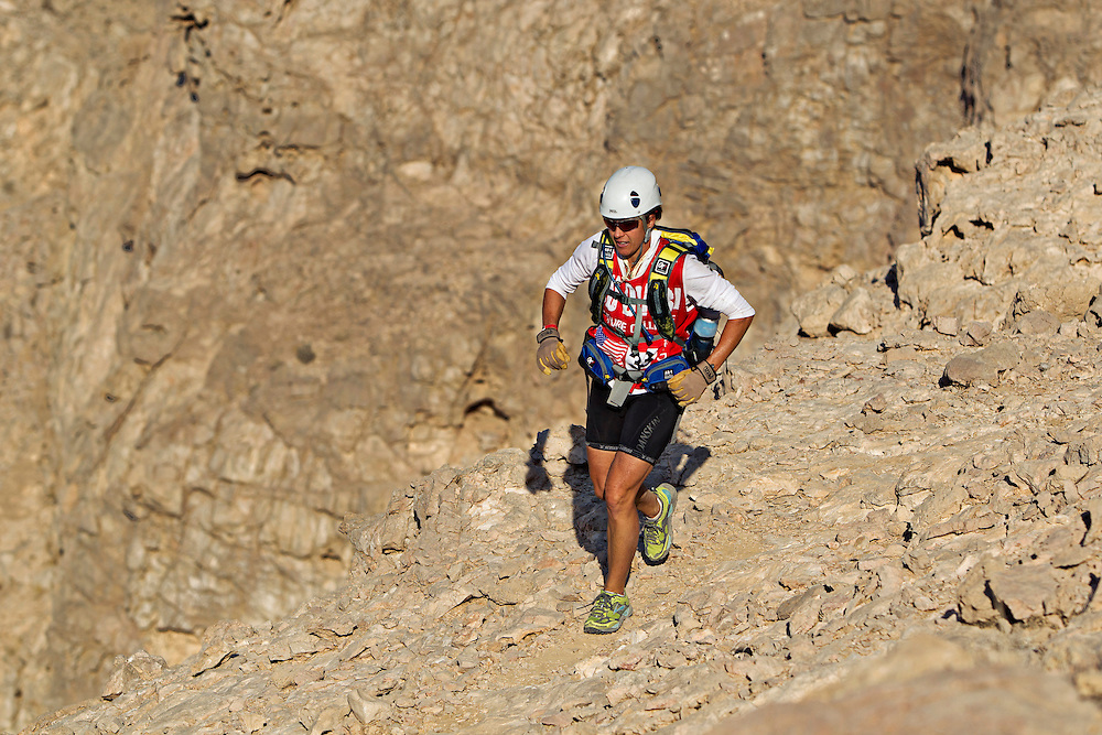 Yankee Scribes' Sheila Taormina races across the trecherously loose terrain of Jebel Hafeet - Abu Dhabi's highest peak...4th Annual Abu Dhabi Adventure Challenge..December 10th through December 15th, 2010. ..The Abu Dhabi Adventure Challenge (ADAC) is a 6 Day staged endurance race consisting of disciplines such as mountain biking, trekking, canoeing, sea kayaking, abseiling, running, and swimming. Coed teams of 4 will attempt to tame this beast of a course through the beautiful Emirate of Abu Dhabi, UAE..Photo by Chris Radcliffe