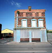 An abandoned business building on the Dock Road, by the river Mersey in Liverpool. The Mersey is a river in north west England which stretches for 70 miles (112 km) from Stockport, Greater Manchester, ending at Liverpool Bay, Merseyside. For centuries, it formed part of the ancient county divide between Lancashire and Cheshire.