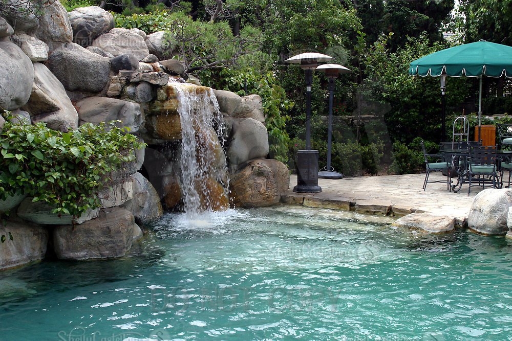 Jul 21, 2002; Holmby Hills, California, USA; Enterance to the infamous grotto lagoon at the Playboy Mansion.<br /> <br /> 1973, famed Playboy publisher/editor Hugh Hefner introduced the world to his version of a modern-day Xanadu, the iconic property known as the Playboy Mansion West. A wildly imaginative adult playground, the property conveyed the extreme luxury and personal freedom that reflected the cultural ethos embodied in Hefner's revolutionary publication.<br /> <br /> Located in Holmby Hills, a wealthy Los Angeles enclave famous for its celebrity residents, the 5.3-acre estate features a 29-room Gothic/Tudor estate home originally built in 1927. Hefner purchased the property in 1970 and quickly set in motion a massive renovation that would result in one of the most photographed, distinctive and storied residences of the 20th Century.