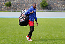 Judas Moseamedi carries a bag of balls off the field after his team's morning training session during the Cape Town City FC Media Open Day held at the Greenpoint Athletics Stadium in Cape Town, Western Cape, South Africa on the 19th August 2016.<br /> <br /> Photo by: Mark Wessels / Real Time Images.