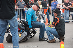 Rob Grimsley, a Harley-Davidson Regional Policerep, explains how to pick up a bike with very little effort at the Harley-Davidson Display during Daytona Bike Week. Daytona Beach, FL. USA. Monday March 13, 2017. Photography ©2017 Michael Lichter.