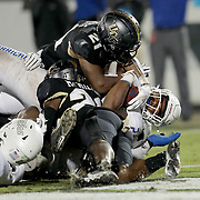 ORLANDO, FL - OCTOBER 03: T.K. Wilkerson #21 of the Tulsa Golden Hurricane scores a touchdown past Derek Gainous #21 of the Central Florida Knights and Jermaine McMillian #26 of the Central Florida Knights at Bright House Networks Stadium on October 3, 2020 in Orlando, Florida. (Photo by Alex Menendez/Getty Images) *** Local Caption *** T.K. Wilkerson; Derek Gainous; Jermaine McMillian
