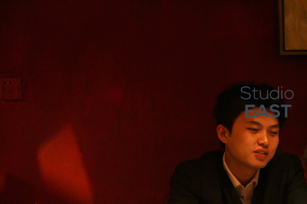 A young man in a tea house in Suzhou, Jiangsu province, China, on October 27, 2007. Photo by Lucas Schifres/Pictobank