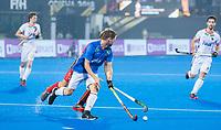 BHUBANESWAR (INDIA) - Martin Haner (Ger) als vliegende keeper met Dieter Linnekogel (Ger) en  Antoine Kina (Belgie) ,   tijdens kwartfinale Duitsland-Belgie  bij het WK Hockey heren. COPYRIGHT KOEN SUYK