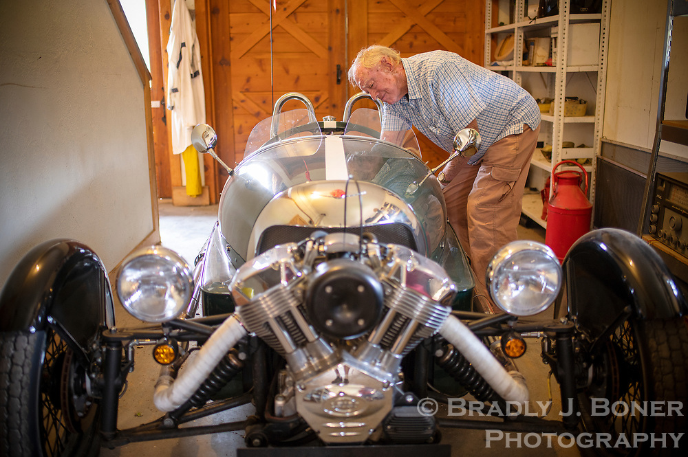 Charlie Peet starts up his 2015 Morgan three wheeler at his home southeast of Hoback late last month. Collecting unique cars is just one of Peet's hobbies over a storied life of 89 years.