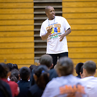 """060613       Adron Gardner\Independent<br /> <br /> Gallup girls basketball coach Kamau Turner speaks to the girls and boys basketball camp at Gallup High School in Gallup Thursday.  """"Before you learn how to do it fast, you have to learn how to do it right,"""" Turner said."""