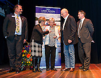 Ron Magoon Franklin Savings Bank and Ellen Husband present Beverly and Jeff Brewer the Hurst Award with guest speaker Kevin Skarupa of WMUR during the Lakes Region Chamber of Commerce 2015 Community Hero Awards at the Winnipesaukee Playhouse on Tuesday evening.  (Karen Bobotas/for the Laconia Daily Sun)