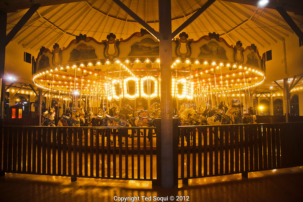 A carousel at the Santa Monica Pier at night.