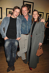 Left to right, ?, HUGO BURNAND and his wife at an exhibition of Joth Shakerley's photographs 'The Rainbow Tribe' held at 49 Glebe Place, London SW10 on 13th November 2007.<br /><br />NON EXCLUSIVE - WORLD RIGHTS
