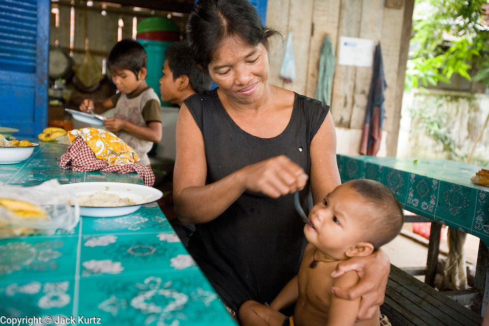 27 JUNE 2006 - SIEM REAP, CAMBODIA: Breakfast at Handicap International in Siem Reap, Cambodia. Handicap International helps Cambodians maimed by mines and unexploded ordinance as well as traffic accidents and disease adjust to a life without limbs. Cambodians are still wrestling with the legacy of the war in Vietnam and subsequent civil wars. At one time it was the most heavily mined country in the world and a vast swath of Cambodia, along the Thai-Cambodian border, is still mined. In 2004, more than 800 people were killed by mines and unexploded ordinance still found in the countryside.  Photo by Jack Kurtz