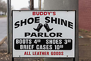 Buddys Shoe Shine Shop sign on 5th March 2020 in downtown Dothan, The Peanut Capital of the World, Alabama, United States of America. Buddy has been shining shoes for 50 years. Buddy doesnt say a whole lot, and he doesnt charge a whole lot either. ... Buddys shoe shining, a smile, a handshake and a couple of bucks can get your shoes heading in the right direction.