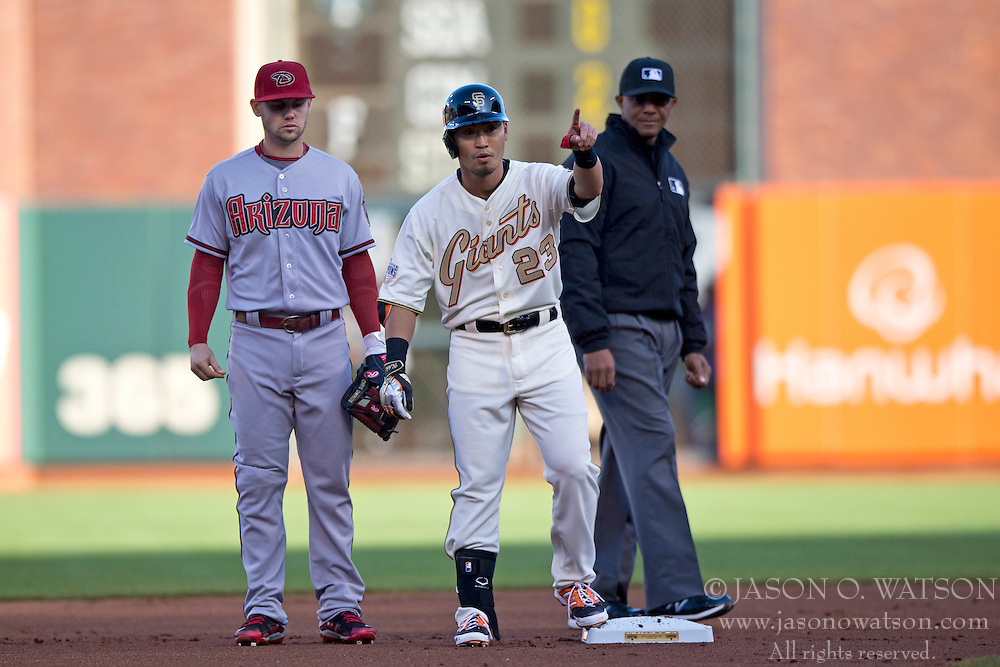 SAN FRANCISCO, CA - APRIL 18:  Nori Aoki #23 of the San Francisco Giants celebrates in front of umpire CB Bucknor #54 and Chris Owings #16 of the Arizona Diamondbacks after hitting a double during the first inning at AT&T Park on April 18, 2015 in San Francisco, California.  The San Francisco Giants defeated the Arizona Diamondbacks 4-1. (Photo by Jason O. Watson/Getty Images) *** Local Caption *** Nori Aoki; CB Bucknor; Chris Owings