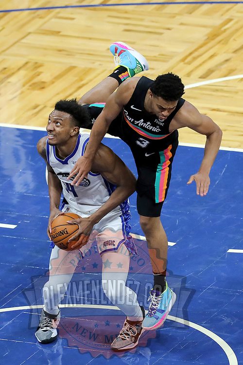 ORLANDO, FL - APRIL 12: Keldon Johnson #3 of the San Antonio Spurs falls over Wendell Carter Jr. #34 of the Orlando Magic as he attempts a shot during the second half at Amway Center on April 12, 2021 in Orlando, Florida. NOTE TO USER: User expressly acknowledges and agrees that, by downloading and or using this photograph, User is consenting to the terms and conditions of the Getty Images License Agreement. (Photo by Alex Menendez/Getty Images)*** Local Caption *** Keldon Johnson; Wendell Carter Jr.