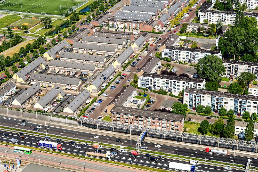 Nederland, Zuid-Holland, Dordrecht, 10-06-2015; Wielwijk, wijk van Dordrecht, afgeschermd van de passerende A16 door monumentaal geluidsscherm.<br /> Monumental noise barrier protects neighbourhood.<br /> <br /> luchtfoto (toeslag op standard tarieven);<br /> aerial photo (additional fee required);<br /> copyright foto/photo Siebe Swart