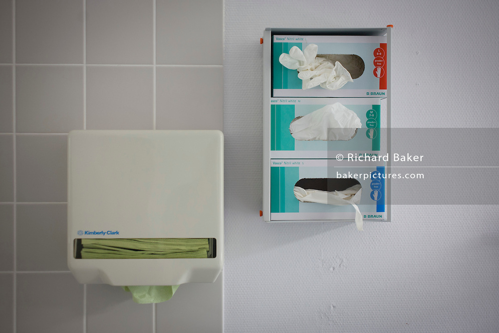 Paper towel and gloves dispensers in German Red Cross hospital, Berlin.