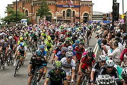 © Licensed to London News Pictures. . LONDON UK.<br /> 7th_JULY_2014.<br />  2014 Tour de France  Peloton runs through Plaistow, Newham in the East end of London. on the third stage of the race that started in Yorkshire two days before. <br /> Photo credit : ANDREW BAKER/LNP