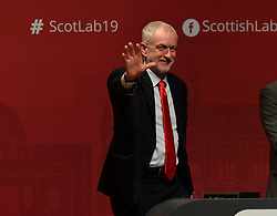 Labour leader Jeremy Corbyn listens to the keynote speech by Scottish Labour leader Richard Leonard at the Scottish Labour spring conference 2019 in Dundee.<br /> <br /> © Dave Johnston / EEm