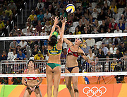 RIO DE JANEIRO, Aug. 17, 2016  <br /> <br /> Bums on show at the Volleyball at Olympics<br /> <br /> OLYMPICS BEACH VOLLEYBALL:  Agatha Rippel Bednarczuk (BRA) blocks point by April Ross(USA) in the semifinals at Beach Volleyball Arena during the 2016 Rio Summer Olympics games. <br /> ©Exclusivepix Media