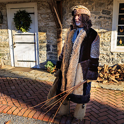 Lancaster, PA, USA – December 7, 2014: An interpreter at the Landis Valley Farm Museum portrays Belsnickel, a traditional German folklore character that visits children before Christmas.