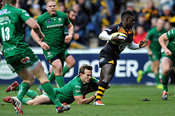 Christian Wade of Wasps takes on the London Irish defence - Photo mandatory by-line: Patrick Khachfe/JMP - Mobile: 07966 386802 21/12/2014 - SPORT - RUGBY UNION - Coventry - Ricoh Arena - Wasps v London Irish - Aviva Premiership