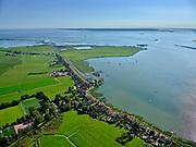 Nederland, Noord-Holland, Amsterdam, 02-09-2020; Durgerdam met Durgerdammerdijk, Uitdammerdijk richting Kinselmeer. IJsselmeer met Marken en Flevoland aan de verre horizon.<br /> Durgerdam with Durgerdammerdijk, Uitdammerdijk towards Kinselmeer. IJsselmeer with Marken and Flevoland on the distant horizon.<br /> <br /> luchtfoto (toeslag op standard tarieven);<br /> aerial photo (additional fee required);<br /> copyright foto/photo Siebe Swart