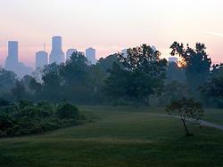 Sunrise behind the Houston, Texas skyline along the Buffalo Bayou Hike and Bike Trail.