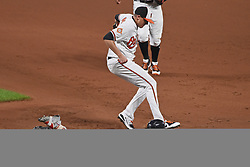 September 19, 2017 - Baltimore, MD, USA - The Boston Red Sox's Brock Holt, bottom, beats Baltimore Orioles pitcher Brad Brach to first base after a coming-backer in the 11th inning at Oriole Park at Camden Yards in Baltimore on Tuesday, Sept. 19, 2017. The Red Sox won, 1-0, in 11 innings. (Credit Image: © Kenneth K. Lam/TNS via ZUMA Wire)
