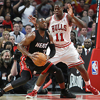 14 March 2012: Chicago Bulls shooting guard Ronnie Brewer (11) defends on Miami Heat shooting guard Dwyane Wade (3) during the Chicago Bulls 106-102 victory over the Miami Heat at the United Center, Chicago, Illinois, USA.